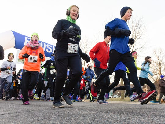 Runners come off the starting line during the Bernick's