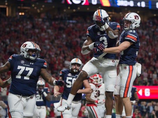 Auburn wide receiver Will Hastings (33) celebrates