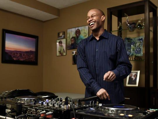 Rodney Page demonstrates his DJ skills Monday, Jan.