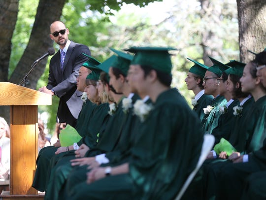 Math and Science teacher Kennon Landis gives the graduation