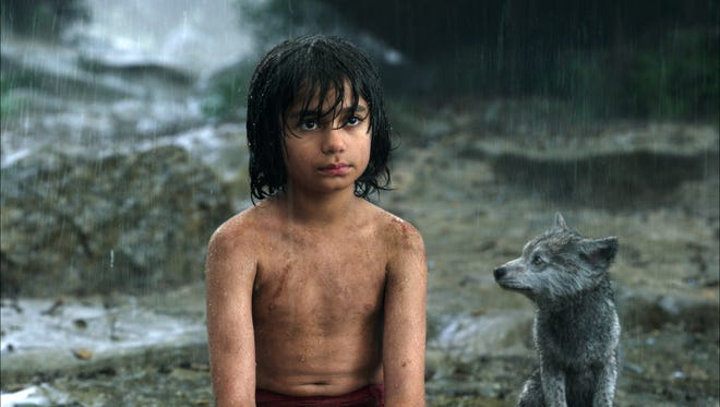 "Mowgli, portrayed by Neel Sethi, left, and Gray, voiced by Brighton Rose, appear in a scene from ""The Jungle Book."""