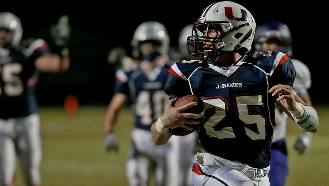 Urbandale's Alex Newberg sprints into end zone to score his team's third touchdown against Indianola in football game at Urbandale High School on Friday, Sept. 26, 2014.