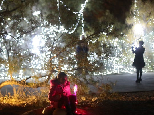"Visitors to The Living Desert in Palm Desert enjoy the annual WildLights holiday light show. The light show will run on selected days until Dec. 31. The Living Desert's ""Mildly Wild New Year's Eve Party is set for Saturday from 5 p.m. to 10 p.m."