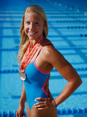 Michelle Konkoly, is shown in a portrait on Aug. 20, 2015, at YMCA's Norris Pool in Naples. Konkoly,  a swimmer who is a paralympian, brought home three silver medals from the 2015 IPC Swimming World Championships in Glasgow. Konkoly injured herself as a freshman in college swimming for Georgetown after falling out of her 5th story dorm. The Pennsylvania native broke several bones and injured her spine, paralyzing her from the waist down. Through months of strenuous rehab, Konkoly regained feeling in her legs and eventually learned how to walk and swim again. She now swims for the U.S. Paralympic National Swim Team.