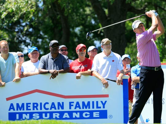 Steve Stricker hits his drive on the ninth hole during