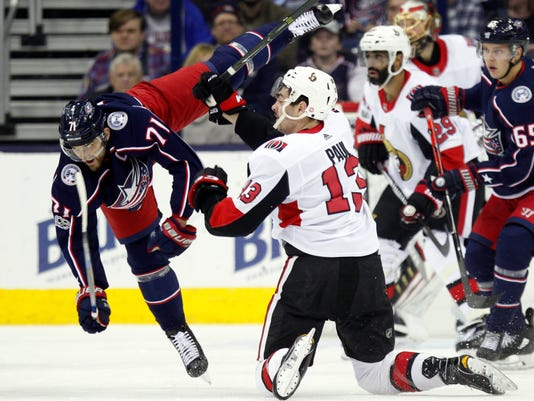 Columbus Blue Jackets forward Nick Foligno, left, collides with Ottawa Senators forward Nick Paul during the first period of an NHL hockey game in Columbus, Ohio, Friday, Nov. 24, 2017. (AP Photo/Paul Vernon)