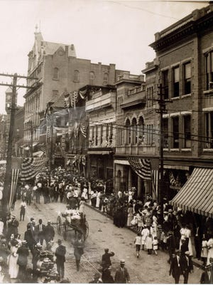 Stauntonians loved a good parade, as is evidenced in this photograph taken July 4, 1911, on a bunting-laced Main Street. The photo, which looks west, was taken from the upper story of one of Staunton's downtown buildings. In the center of the photo is a one-horse buggy. The driver was Leta Watts Gibbs. Sitting next to her is an unidentified black woman holding Mrs. Gibbs' infant, William W. Gibbs IV.