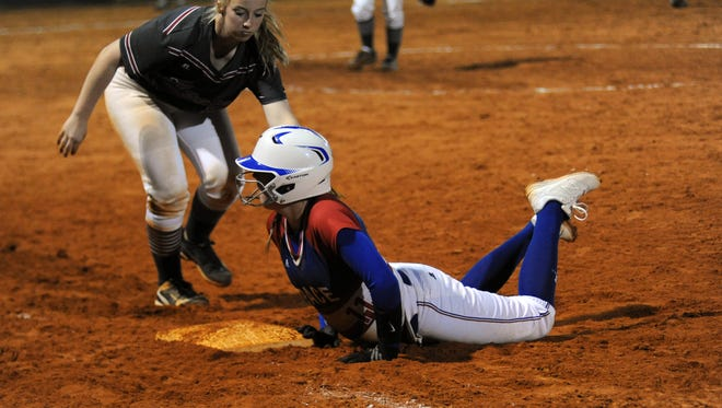 Pace's Emmalyn Womack dives back into first base while Tate first baseman Kayleigh Cawthon applies the tag. Tate defeated Pace 7-2 on March 8, 2017.