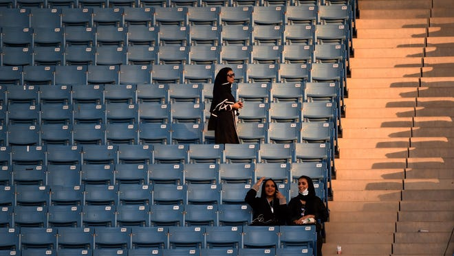 Saudi women arrive at a stadium to attend an event in the capital Riyadh on September 23, 2017 commemorating the anniversary of the founding of the kingdom.