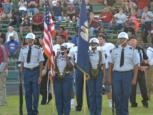 Members of the Peabody color guard presented the flag before the kickoff.