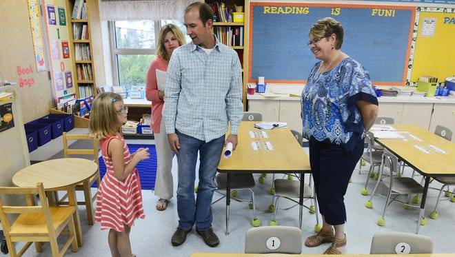 Alison McNab, 7, checks out her new first-grade classroom during a meeting with her teacher Kirsten Bechtold and parents, Stacy and Lance McNab Tuesday evening at Talahi Community School. The St. Cloud school is one hosting meetings with parents to try to set goals and attack achievement gaps.