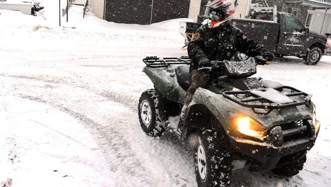 Jared Poole, a volunteer with the Wrightsville Fire Department used his ATV to make his way to the station during a snowstorm in 2014.