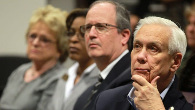 Covington City Commissioner Chuck Eilerman, right, and other commissioners listen Feb. 13 as Kentucky Auditor Adam Edelen explains how money was stolen from the city during Bob Due's tenure as finance director.