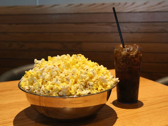 A homey touch: Popcorn is served in a metal mixing