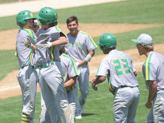 New Deal players celebrate their doubleheader sweep of De Leon to win the Region I-2A semifinal series Saturday at Snyder. New Deal won 4-3 in eight innings and 7-1 on Saturday, after losing the series opener 11-1 in five innings Friday in Stamford.