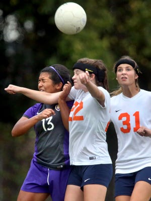 Blackman High began wearing protective headbands during the 2015 season to help limit the number of concussions sustained by players. Emily Nash (22) and Amelia Goodnight (31) are pictured wearing the protective headgear.
