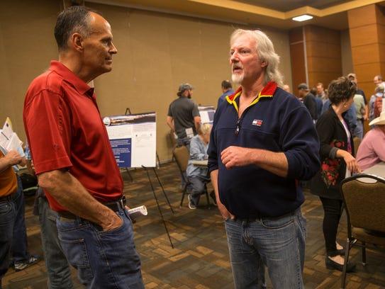 Farmington Mayor Tommy Roberts, left, talks with San