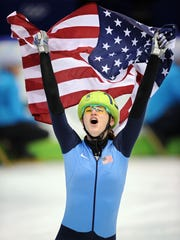 Katherine Adamek (Reutter) celebrates winning the silver medal in the 1,000 meters in short-track speedskating during the 2010 Vancouver Winter Olympics.