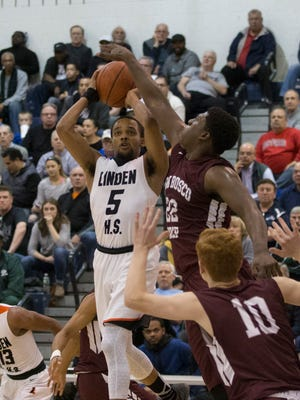 Linden's Mikey Watkins tries to shoot over Don Bosco's Marcellus Earlington during the second half of the Tournament of Champions semifinal on Sunday at Pine Belt Arena.