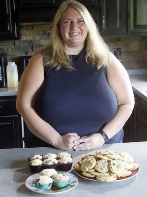 Calli Dilyard with her chocolate chip cookies and blueberry muffins.