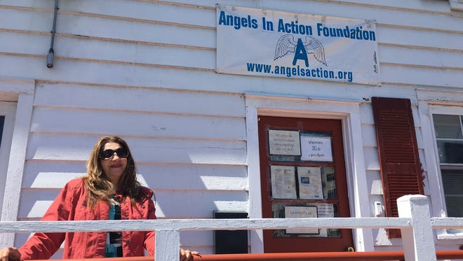 Carmen Salavarrieta, Angels For Action Inc. co-founder and director, outside the West Second Street building in Plainfield.