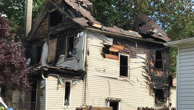 A woman was seriously burned in a Bergen Street, Plainfield house fire early Tuesday.