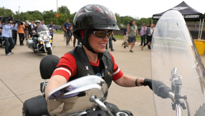 U.S. Sen. Joni Ernst (R-Iowa) rides away on her Harley-Davidson motorcycle during the 2015 Roast and Ride on Saturday, June 6, 2015, which started at the Big Barn Harley-Davidson dealership in Des Moines, Iowa.