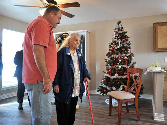 Brian Bohn helps Maxine as she sees her new house