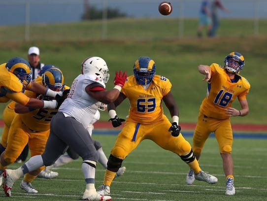 Angelo State quarterback Carsen Cook fires a pass last