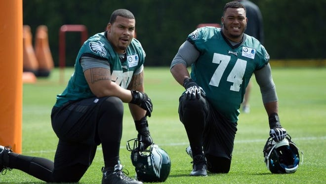 Eagles offensive lineman Malcolm Bunche, right, a Newark High grad, hopes to make the 53-man roster.