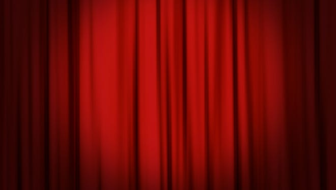 Spot on a red curtain