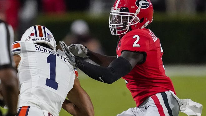 Oct 3, 2020; Athens, Georgia, USA; Georgia Bulldogs defensive back Richard LeCounte (2) pushes Auburn Tigers wide receiver Anthony Schwartz (1) out of bounds during the first half at Sanford Stadium. Dale Zanine-USA TODAY Sports
