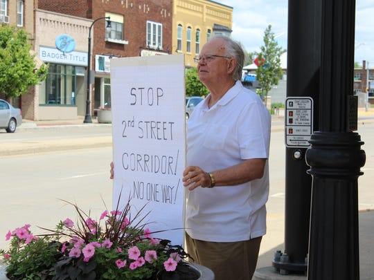 The Second Street corridor project has generated debate among citizens. In June, city resident Carl Scott protested the one-way street proposal.