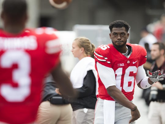 Ohio State quarterback J.T. Barrett loosens up on the