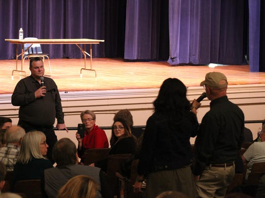Sen. Jon Tester fields questions from the packed auditorium of Helena Middle School on Friday.