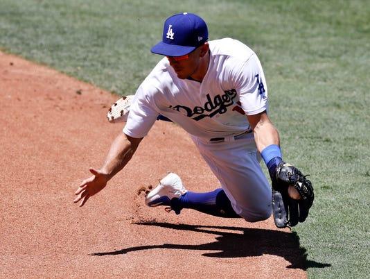 636340263055717781-AP-APTOPIX-Rockies-Dodgers-B.jpg