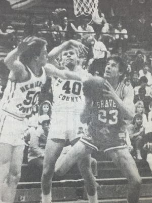 Brian Tucker (#23) went up to shoot in a game against Henderson County in February 1986.