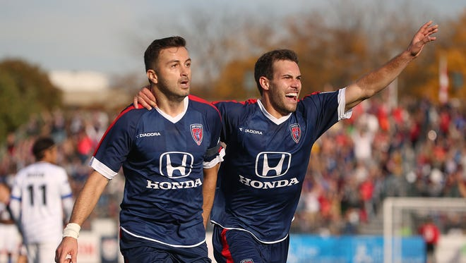 Indy Eleven midfielder Siniaa Ubiparipovic (10) and Indy Eleven midfielder Dylan Mares (6) celebrate Ubiparipovic's goal during playoff semifinals between Indy Eleven and FC Edmonton, at IUPUI's Michael A. Carroll Stadium, Indianapolis, Saturday, November 5, 2016.