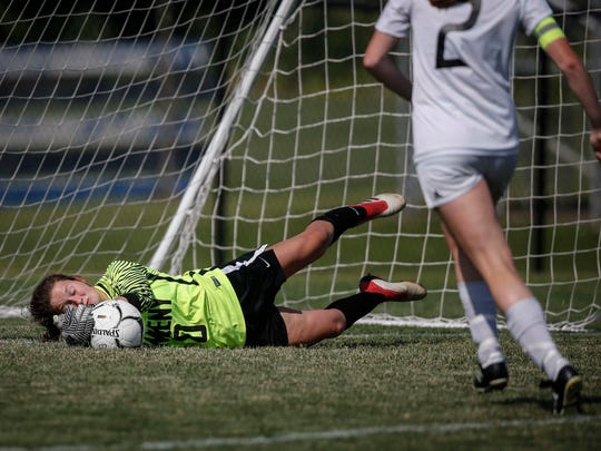 Ankeny goalkeeper Brenny Frederick stops a shot at the net against Ankeny Centennial during the Class 3A championship game in 2018. Frederick and Sidney Truman have been splitting time at the goalkeeper spot this season.