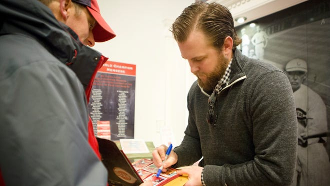 Thu., Jan. 26, 2017: Reds right-handed relief pitcher Drew Storen, who was recently signed to the Reds, signs autographs for fans before the annual Cincinnati Reds Caravan departed Thursday morning from Great American Ball Park.