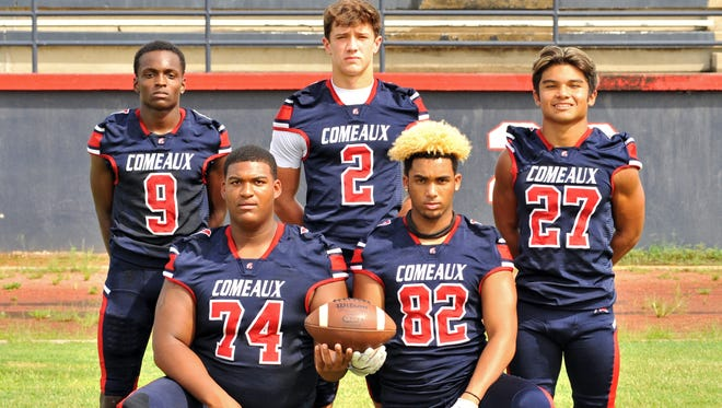 Quarterback Brett Dotson (2) leads the Comeaux Spartans into the season along with two of his favorite targets Tenarious Achan (9) and Jaylon Johnson (82). Tikki Pascual will look to give the Spartans balance on the ground game running behind stud offensive lineman Shane Vallot (72).