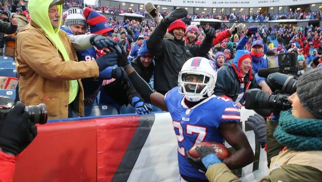 Bills cornerback Tre'Davious White celebrates with fans after his interception sealed a 24-16 win for Buffalo over Miami.
