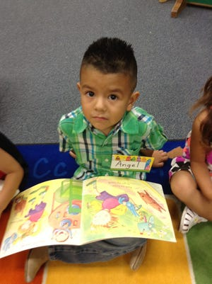 Angel Juarez-Rodriguez in a reading class on his first day of preschool at A Stepping Stone Foundation's LEAF program.