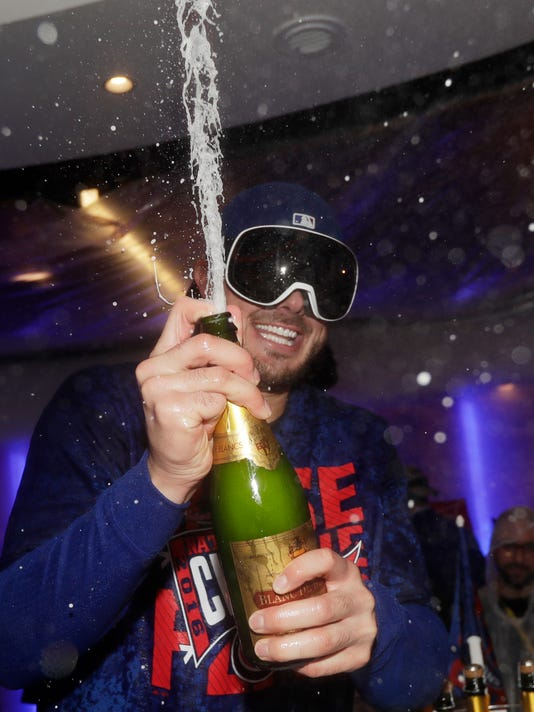 Chicago Cubs third baseman Kris Bryant (17) celebrates after Game 6 of the National League baseball championship series against the Los Angeles Dodgers, Saturday, Oct. 22, 2016, in Chicago. The Cubs won 5-0 to win the series and advance to the World Series against the Cleveland Indians. (AP Photo/David J. Phillip)