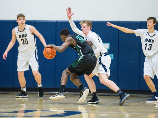 Rice Memorial's Leo Chaikin, left, drives against Mt.