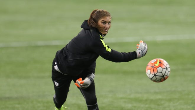 United States Women's National Team goalie Hope Solo works out during the team's practice on Sept. 16, 2015 at Ford Field in Detroit.