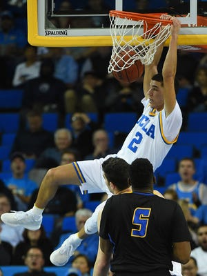 Lonzo Ball dunks in the second half at Pauley Pavilion.