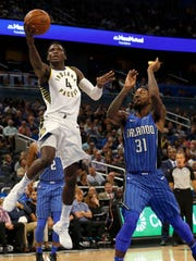 Indiana Pacers guard Victor Oladipo (4) shoots a layup as Orlando Magic guard Terrence Ross (31) defends during the second quarter at Amway Center.