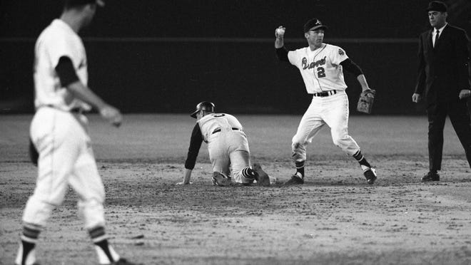 In this April 12, 1966, file photo, Atlants Braves second baseman Frank Bolling (2) throws the ball against the Pittsburgh Pirates during the first Major League Baseball game in the southeast at Atlanta-Fulton County Stadium.