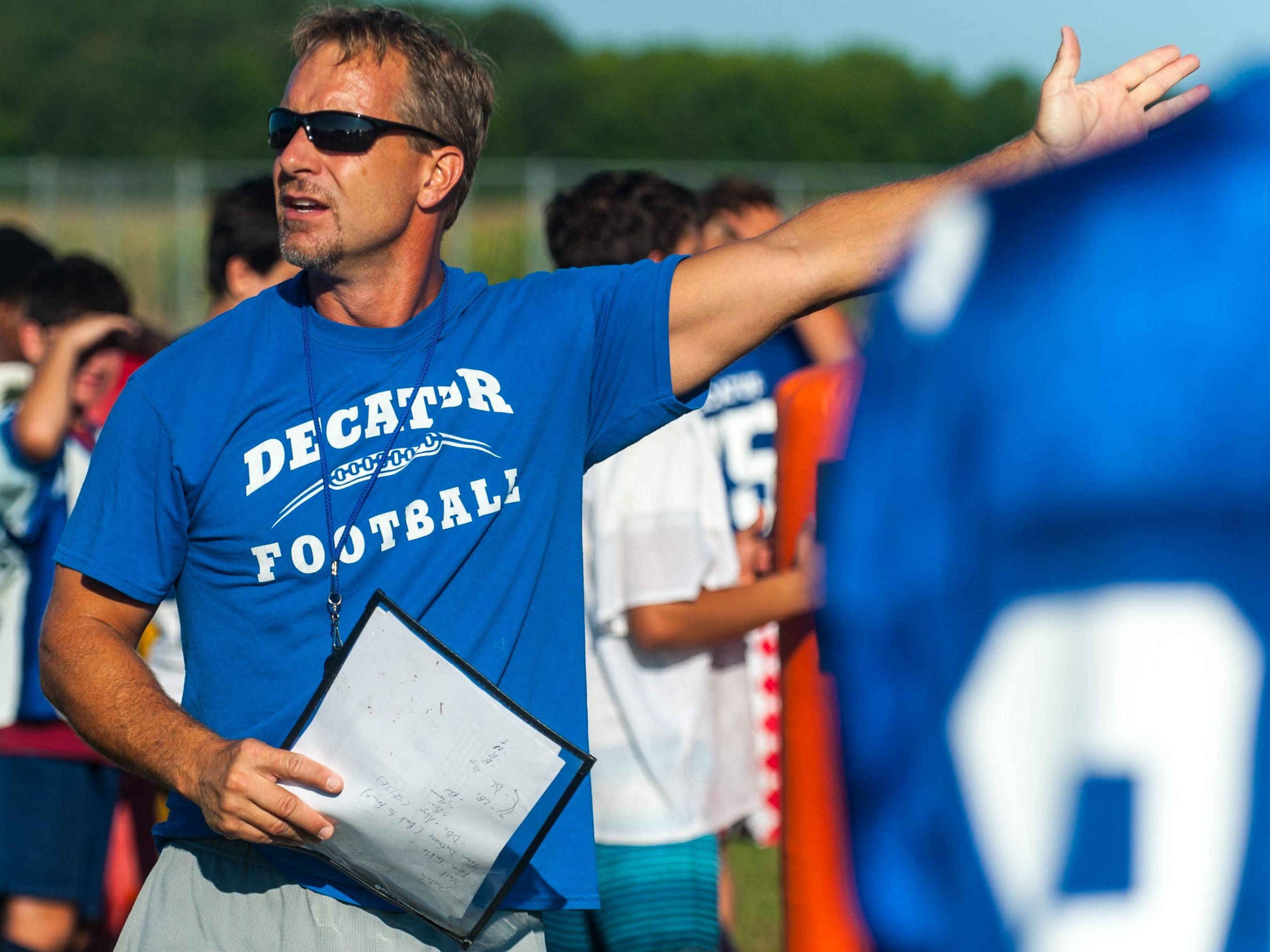 Stephen Decaur defensive coordinator Stan Griffin explains defensive formations on Friday morning in Berlin.